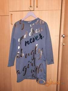 Veoma kvalitetna dobro dizajnirana haljina