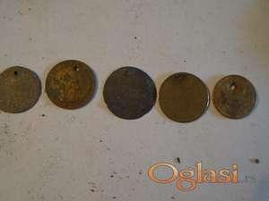 Kovanice  stare koje su bile oko vrata zena
